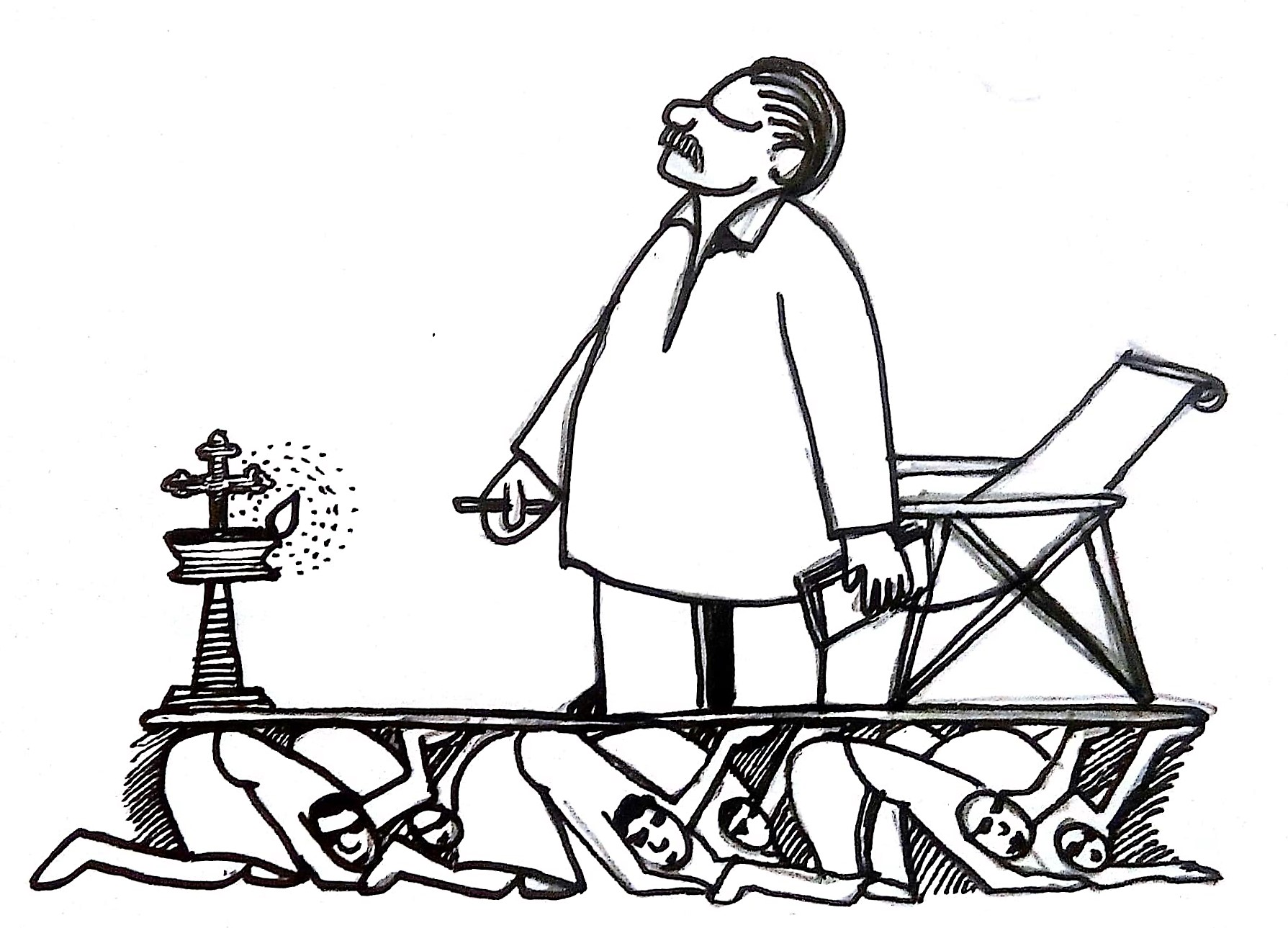 A man in his mundu stands in front of a lit lamp, looking solemnly towards the sky, eyes closed. He is propped up on a platform by people who are kneeling on their knees